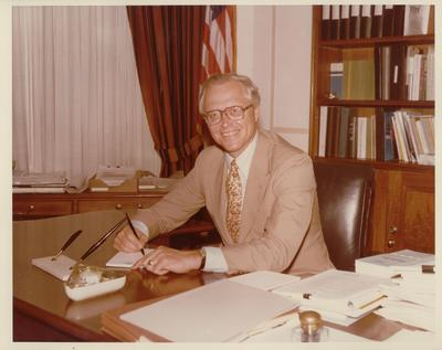 Benjamin R. Civiletti at desk